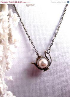 So cute!  http://www.etsy.com/white-satin-pearl tea-pot necklace $20.40