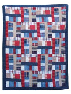 """A fabulous fat quarter quilt pattern so easy you'll want to create dozens!    This quilt is made using just two blocks. Mix and match fabrics, and you can make a stunning quilt using 14 fat quarters. Plaids and stripes make this quilt masculine, but floral fabrics make a smashing feminine quilt as well. Finished size is 64"""" x 78""""."""