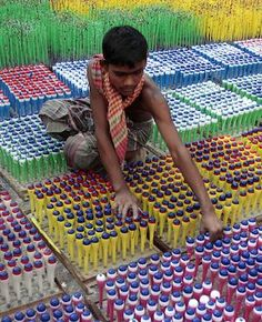 CHILD LABOUR ENDED: A child works at a balloon factory in Dhaka. Bangladesh adopted the National Child Labour Elimination Policy 2010, ending all forms of child labour by 2015. There are about 3.2 million child workers. (AP)
