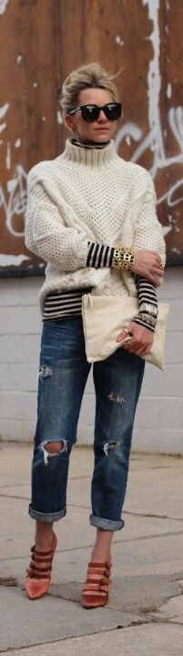 french stripes under a fisherman sweater, shredded jeans and tan pointy heels, white slouchy clutch