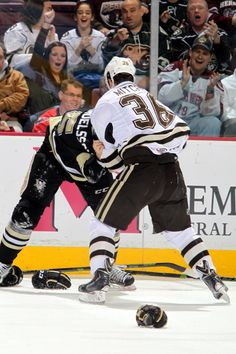 11.16.14 - Garrett Mitchell in a battle with a WBS Penguin player.  Photo courtesy of JustSports Photography