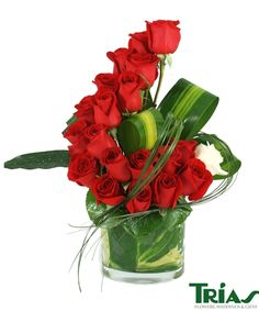 Red rose design with folded aspidestra leaves and beargrass.