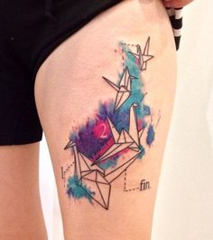 The colorful water color origami birds on thigh.