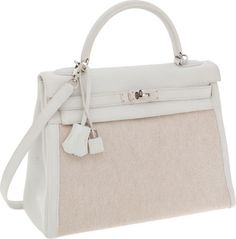 Hermes 32cm White Clemence Leather and Toile Retourne Kelly Bagwith Palladium Hardware.