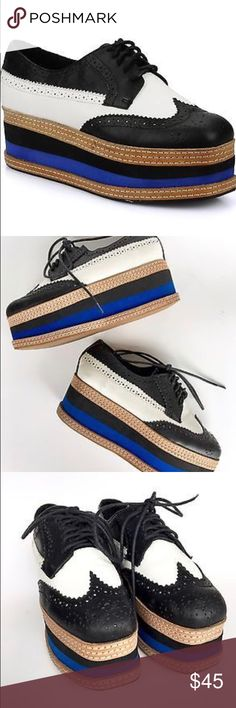 JEFFREY CAMPBELL AD-LONG BROGUE SHOES BLACK WHITE JEFFREY CAMPBELL AD-LONG BROGUE SHOES BLACK WHITE WITH BLUE. NOT MY PICTURES BUT IOL TRY TO TAKE SOME TOMORROW. NO FLAWS PREOWNED. MAKE AN OFFER PLEASE Jeffrey Campbell Shoes