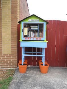 The U.C.C. churches have been focusing on going green so we decided to build our library out of found and reused items. We found an old bookshelf, an old window for the door and used leftover shingles from a member's garage. We chose bright paint colors to make the library stand out. We plan to have an open house to introduce our library to the neighborhood but we have already had patrons exploring our selection!
