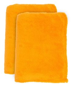 Orange Fleece Throw - Set of Two. . ...  J&M Home Fashions. . ...  $17.99 $30.00  . : Product Description:  Add a pop of colorful panache and fuzzy comfort to the nap game with these plush fleece throws.      Includes two throws  .     50'' x 60''  .     100% polyester  .     Machine wash; tumble dry  .     Imported