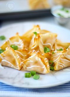 Creamy buffalo chicken wrapped up in wonton wrappers then drizzled in dressing! Baked Buffalo Chicken Wontons are a mouthwatering appetizer done in 12 min! Wonton Appetizers, Wonton Recipes, Best Appetizer Recipes, Cheese Appetizers, Healthy Appetizers, Chicken Recipes, Italian Appetizers, Appetizer Ideas, Yummy Recipes