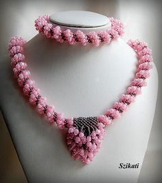 Peyote Stitched Cellini Spiral Necklace and Bracelet in Pink and Grey - Beadwoven OOAK Jewelry - Unique Gift Idea. $110.00, via Etsy.