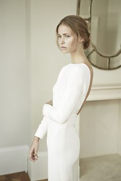 Charlotte Simpson backless long sleeve wedding dress - But I'm thinking that the front should have more details to give it more complexity Wedding Dress Black, Wedding Dress Tea Length, Stunning Wedding Dresses, Long Sleeve Wedding, Minimal Wedding Dress, Minimalist Wedding Dresses, Look Fashion, Runway Fashion, Fashion Decor