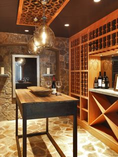 Wine cellar with stone floor and beautiful blown glass lighting