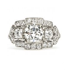 Quimbly is a vintage Art Deco ring centering a 1.03ct Round Brilliant Cut diamond surrounded by diamonds in a geometric setting. Wow! TrumpetandHorn.com // $12,500