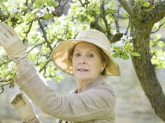 "Isobel Crawley (Penelope Wilton) offers a knowing look at she tends to her trees. | 8 New Photos From ""Downton Abbey"" Season 5"