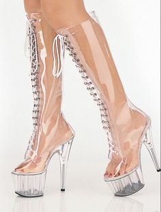 Glass? Looks like plastic to us!    Insane and Weird High Heels - glass heels