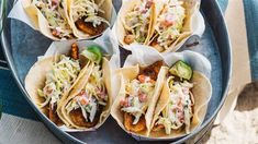 Feed a crowd fast with easy spiced fish tacos topped with crunchy slaw
