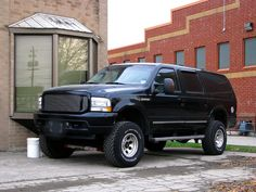 Ford Excursion. Like! Its lifted but not to much this is one out of three of the Ford Excursions I would have in my driveway.