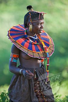 SuperStock - A Pokot woman in traditional dress. Her leather skirt is made from tanned goatskins. #beadwork #Pokot