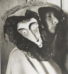 Kati Horna, Remedios Varo, wearing a mask made by Leonora Carrington, 1957