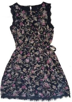 Gorgeous vintage-inspired floral dress for fall. Trimmed with delicate black lace. Flirty and sophisticated.