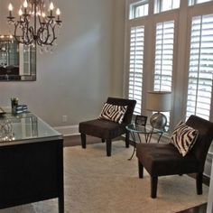 Ivory Walls Lined With Black Crown Molding Beautifully Complement This  Contemporary Home Office Boasting A Black Leather Stool Is Positioned On A  Gu2026