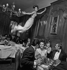 Paris Fashion's photographed by :Melvin Sokolsky.Model Dorothea McGowan wears a dress created by:Givenchy.1965.