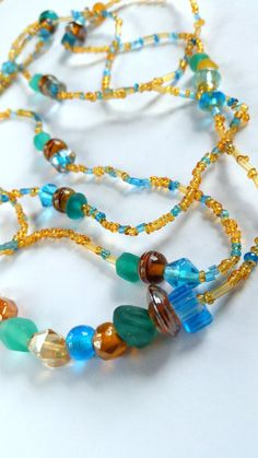 Beautiful vintage 20s flapper handmade necklaces feature sea blue hand blown czech glass beads, amber glass beads and tiny glass seed beads. Measure 24 and 30