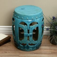 This garden stool comes in a beautiful turquoise color and presents a vintage design. Handmade by artisans in china, this stool is crafted of clay and ceramic.