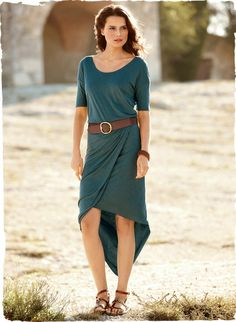 Perfect for travel or workdays, this versatile dress is constructed of two lightweight layers of viscose jersey for an easy, drapy silhouette. Designed with drop shoulders, elbow-length sleeves and an elasticized waist that flows into a crossover skirt with an asymmetrical hem; in Deep Teal.