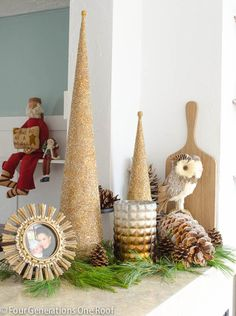 The gold glittered trees and oversized pinecones from  create a perfect vignette in this family room.