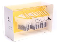 A lovely design where tea can hang around in the box or on the edge of a tea cup.