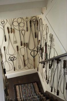Tony Bill's collection of vintage rug beaters numbers about and the walls of the staircase leading to the basement in a 1870 farmhouse in Connecticut are a Calder-esque celebration of these fun, functional wire forms. Country Farmhouse Decor, Farmhouse Style, Country Chic, Country Living, Home Design, Interior Design, New England Homes, Displaying Collections, House And Home Magazine