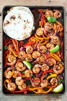 One Sheet Pan Shrimp Fajitas - tender juicy shrimp with roasted bell pepper and onion served in a soft warm tortilla. Perfect easy dinner idea!