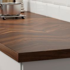 IKEA's description: The herringbone pattern has a beautifully pleasing geometry to the eye. In BARKABODA countertop the pattern in dark brown wood adds true elegance to the kitchen. The countertop is made durable with a layer of solid wood that covers a particleboard core. This technique not only gives a genuine expression of solid wood, but is a good environmental choice as it's resource-efficient. Living up to water, moisture, heat and scratches, BARKABODA countertop becomes the perfect…