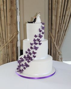 Simple yet so detailed with beautiful purple butterflies leading up to this hilarious cake topper! Butterfly Wedding Cake, Purple Butterfly, Cakes Today, Favours, Macarons, Yummy Treats, Cake Toppers, Food To Make, Butterflies