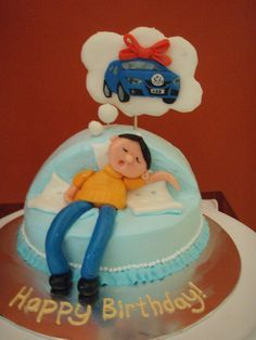 Guy dreaming of volkswagen - My first paid cake.  For a friend who would like to upgrade to a Volkswagen Golf but wife said 'No'.  Its an orange cake with chocolate filling.  Fondant accents.  2D fondant car on white chocolate dream 'cloud'. The fondant slips as the icing softens.  I hope the cake make it till the end of the party!