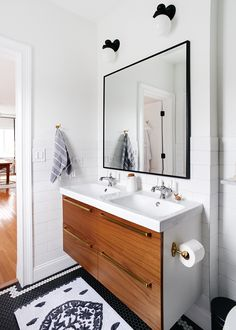Our black and white bathroom, with warm wood and mixed metals! | via Yellow Brick Home