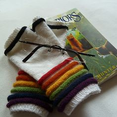 Ravelry: Ringele (fingerless mitts) pattern by ela m.  Rainbow Brite gloves may be something I need in my life desperately!