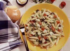 Greek Pasta Salad ~ penne with feta, tomato, cucumber, black olives, green pepper, parsley, green onions; combine and let marinate in the refrigerator before serving; enjoy