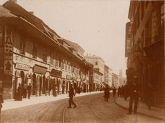 Krakowska street, 1908, with ypical rounded entrances to the shops. Kazimierz Town Hall in the background. Narrow-gauge tram rails in the street. Photo F.Klein. National Archives in Krakow