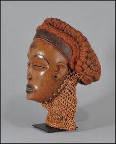 Africa |  Chokwe Pwo Passport Mask, from Angola or DR Congo.  Wood, Fibre and Beads |  Chokwe Pwo is a femal mask, when masqueraded, the performance should be entertaining, in that it is a comedy of manners or social satire.