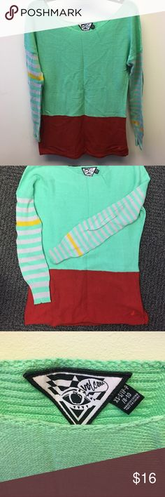 Volcom Multicolor Long Sweater Perfect over leggings, solid red on bottom with volcom logo on bottom, aqua colored with cute yellow stripes on sleeves, comfortable, excellent condition Volcom Tops