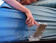 The Holding Cell is simple to use and can be mounted beside the bed by sliding the panel under the mattress so your phone is within arm's reach, perfect for cell phones and baby monitors.