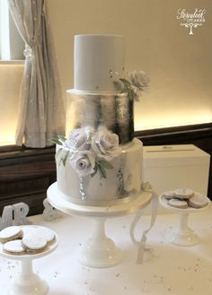 Wedding cake with silver, grey marble effect and lavendar grey roses