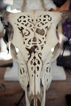 Carved cattle skull.
