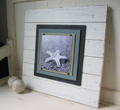 Love these distressed wood plank picture frames. Would be so cute in a western-themed room or beach inspired room.