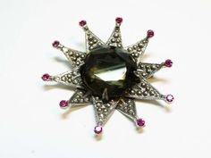 Fall Sale - Marked Down 20% ! #GiftIdeas Capri Signed Starburst Brooch with Huge Center Stone - #Vintage Marcasite Pin offered by TheJewelSeeker  This is an outstanding piece of Mod or Retro jewelry.  The brooch is... #vintage #jewelry #teamlove #etsyretwt #ecochic #thejewelseeker