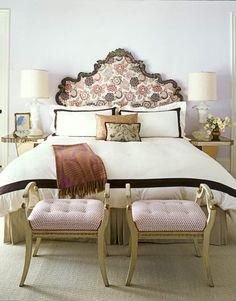 In the master bedroom, a 19th-century Italian headboard is upholstered in Osborne & Little's Tamara.
