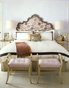 In the master bedroom, a 19th-century Italian headboard is upholstered in Osborne & Little's Tamara.