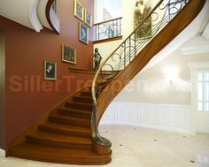classic stair design, metal railing and wood handrail, handmade http://www.sillertreppen.com/en/siller-stairs/
