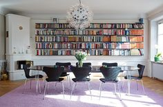 Big dining table, lots of books. I can imagine great conversation happening in this room.